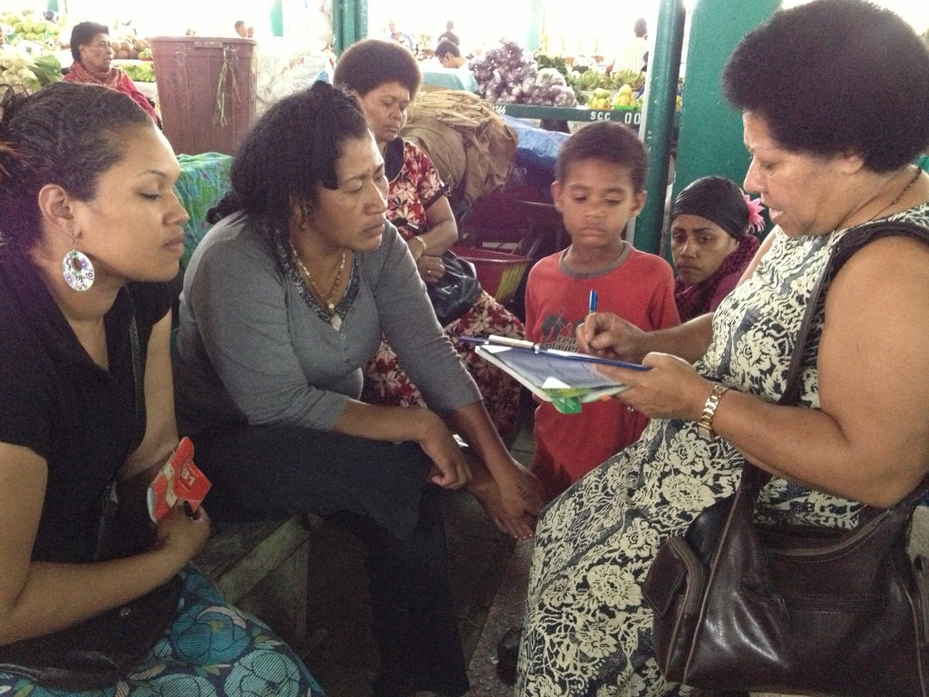Kuini Lutua (right), who will be our Project Manager, discussing work issues with women in the marketplace