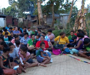 Garment workers gather for a meeting in their community