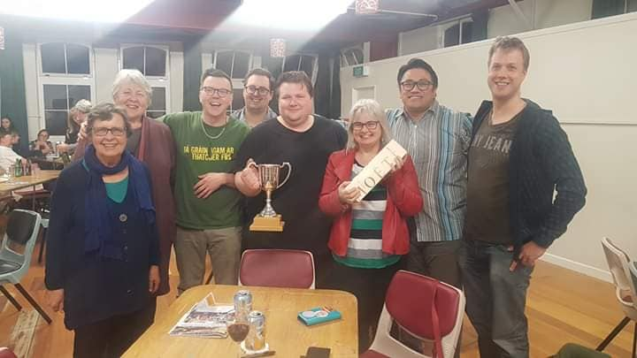 PSA quiz team hold the UnionAID trophy proudly